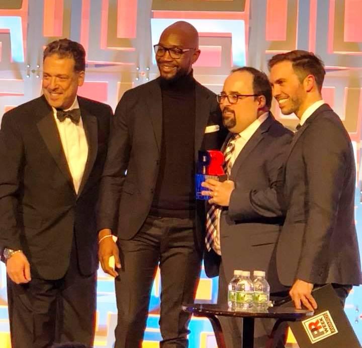 DePaul alum Aaron Westbrook and Dr. Matt Ragas accept PRWeek Award